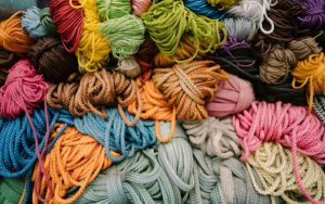 Various yarns and fibers of various colors.