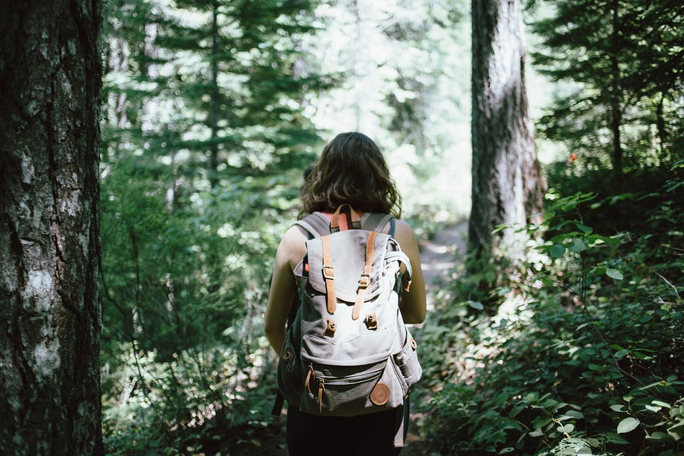A woman hiking in the woods.