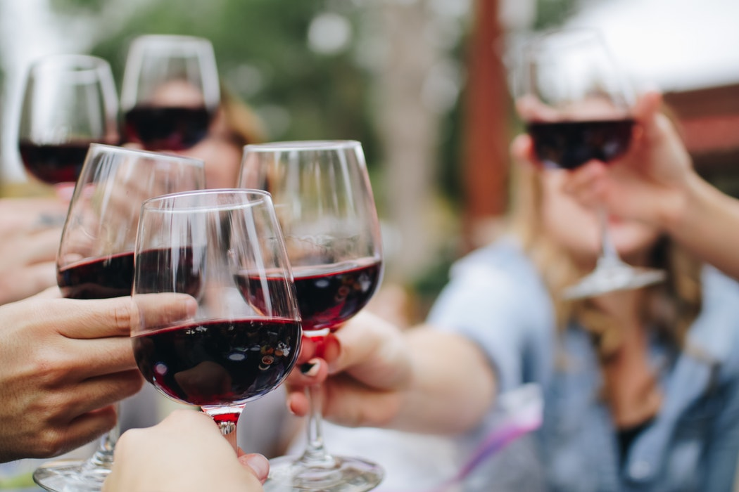 A group of people drinking wine.