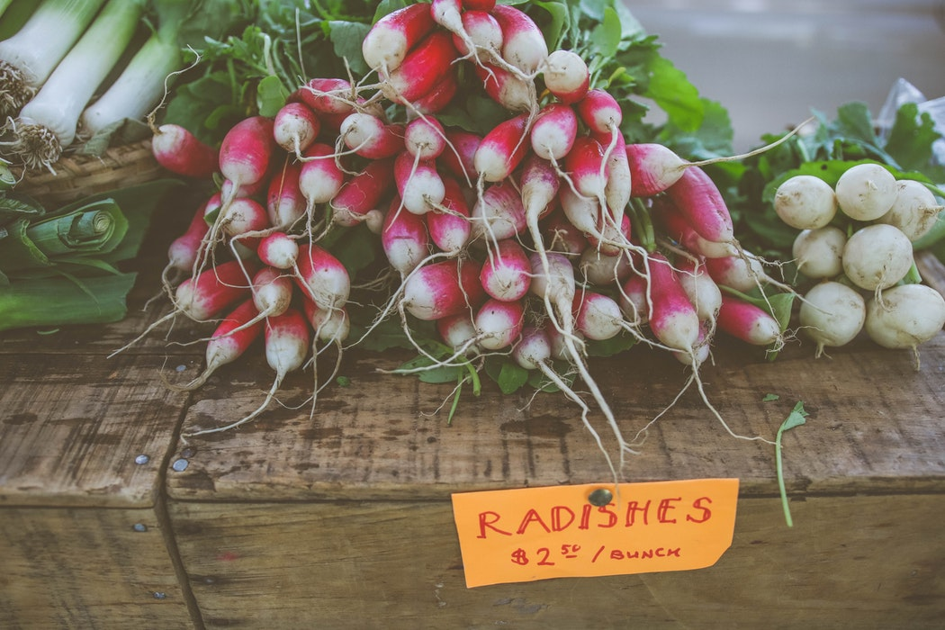 Radishes for sale at a farmers' market.
