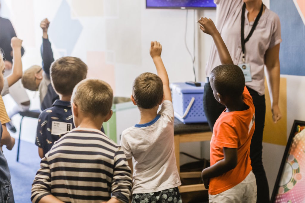 Students raising their hands in Northeastern Mississippi's School Districts